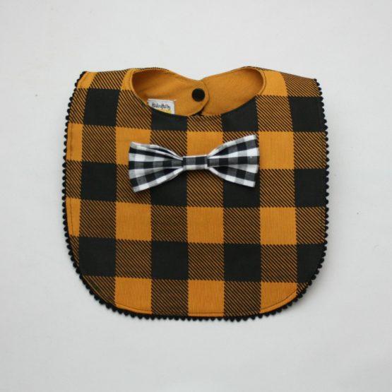 Mustard checkered bib with black and white tie